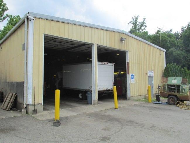 building building Steelsmith-SteelBuilding-Garage-CoryBrothers-Truck