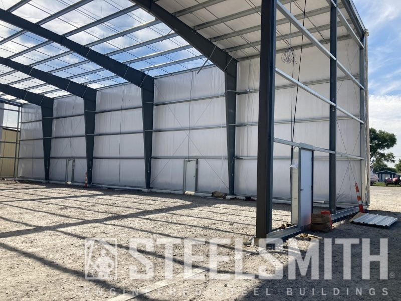 Partially sheeted, walk doors in