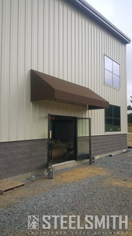 Awning complete over double walk door side view (1)