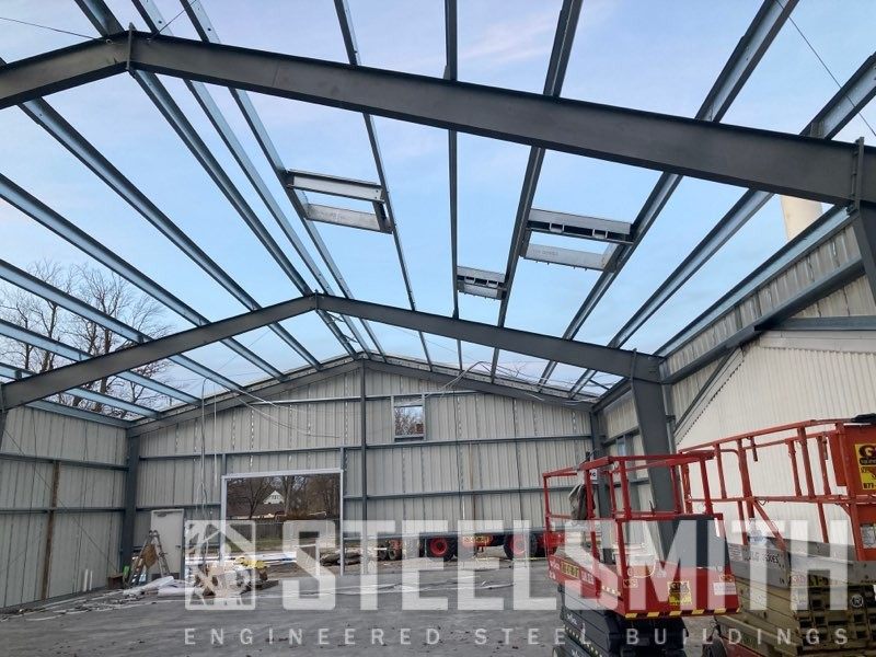 Roof and skylight openings framed, walls sheeted