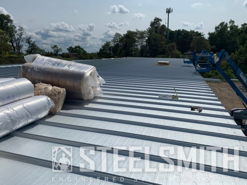 Roof with rolls of insulation on it