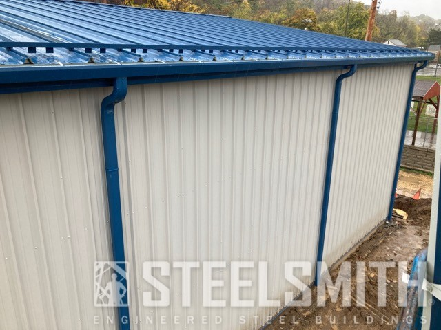 Sidewall gutters and downs and snowguards