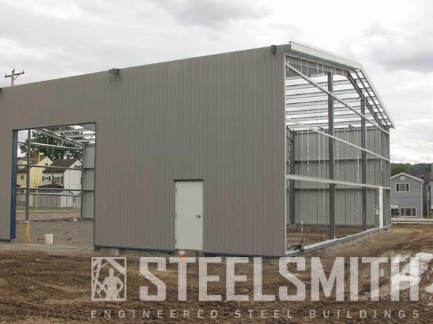Sidewall sheeted, mandoor in, OHD opening framed Sharpsburg